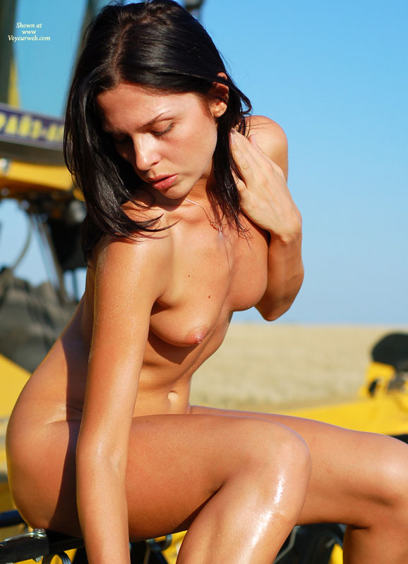 Girl Sitting Nude On Construction Equipment - Black Hair, Small Breasts, Naked Girl, Nude Amateur , Bent Over, Looking Down Pose, Nude Profile Of A Girl, Wet Skin, Fully Nude, Seated, Side View